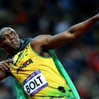 [Skalij, Wally -- - LONDON, ENGLAND AUGUST 5, 2012-Jamaica's Usain Bolt strikes a pose after winning the gold medal in the 100 meters at the 2012 London Olympics on Sunday. (Wally Skalij/Los Angeles Times)] *** []