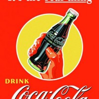 coke-real-thing-bottle-in-hand-posters
